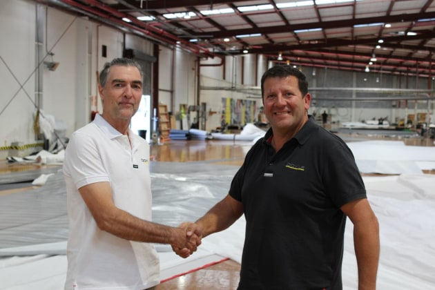 L to R: Andrew Lechte shakes hands with Doyle Sails Managing Director David Duff at the Doyle Sails New Zealand loft.