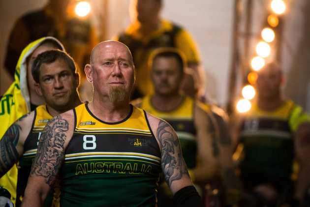 The Australian Invictus Games wheelchair rugby team, led by Jeff Wright and followed by Matt Brumby, prepare to take to the court prior the finals match against France, at Sydney Olympic Park. Defence
