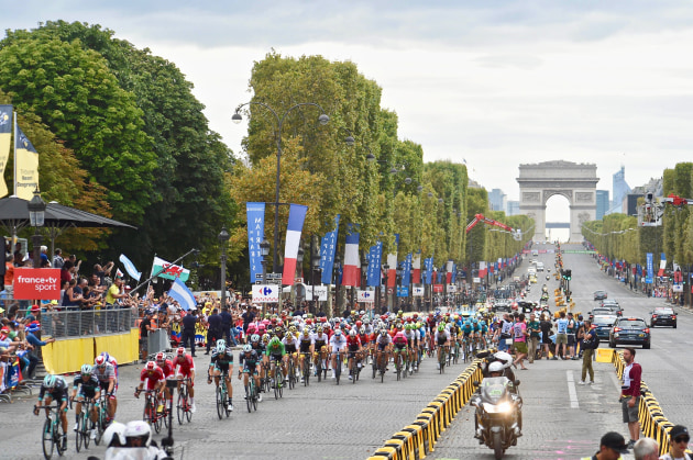 Riders of the 2018 Tour de France make their way along the Champs de Elysees during the finishing circuits of the 2018 Tour. Image: Sirotti