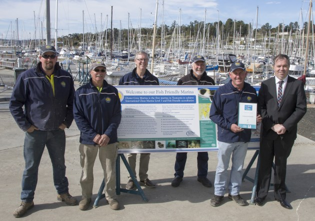 Tasmanian state MP, Nic Street (right), presents the Fish Friendly certificate to Phil Boustead, Oyster Cove marina manager.