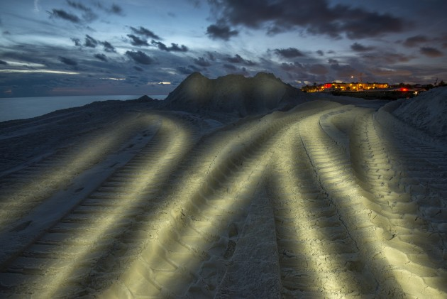 In areas of Florida beach nourishment is still used to beatify the beaches and some of which are used for nesting. To create an interesting image of this element of the photographic essay, I waited until nightfall and light-painted the excavator tracks, which looked similar to turtle tracks.