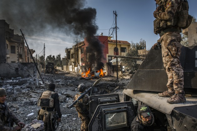 Iraqi Special Forces soldiers surveyed the aftermath of an ISIS suicide car bomb that managed to reach their lines in the Al Andalus neighbourhood of East Mosul. January 2017. Ivor Prickett for The New York Times.
