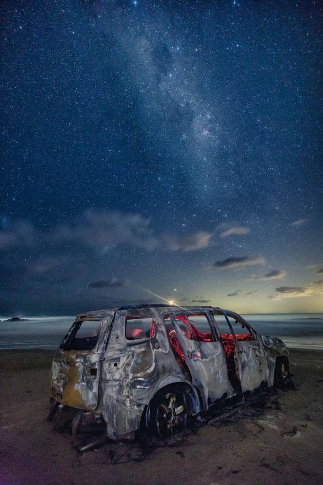 An burnt abandoned car on Birrubi Beach in Anna Bay, NSW, Australia.