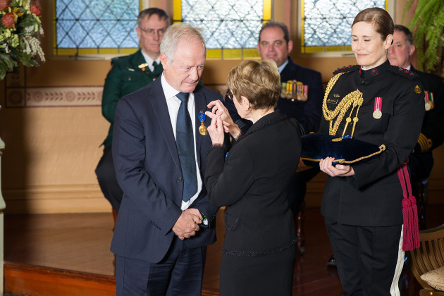 Governor Beazley invests Alf Taylor as a Member of the Order of Australia (AM).