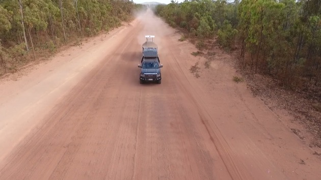 Corrugated tracks and red dust: the AMM combo on the road.