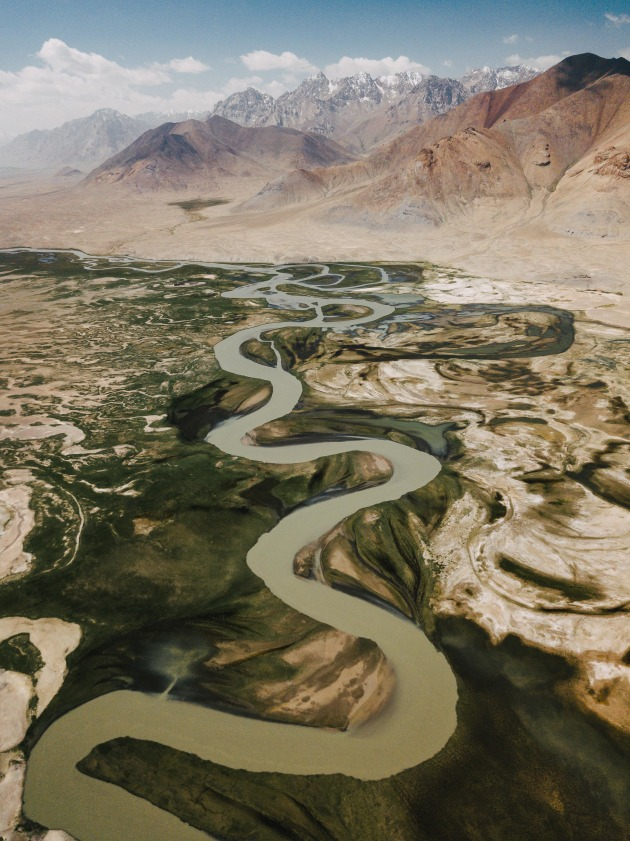 Tajik Serpent. I spotted this river winding its way in eastern Tajikistan. I knew that there could be some abstract patterns but was utterly blown away with what I saw instead. The snaking river leads perfectly towards the peaks in the distance. DJI Mavic Pro. 1/100s @ f/2.2, ISO 166. +0.34EV.