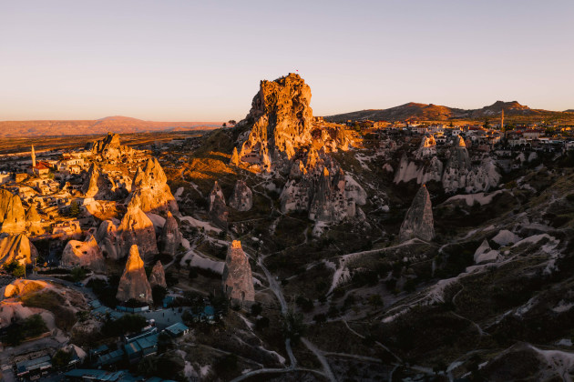 Uchisar Castle, Cappadocia, Turkey. The pointy shape of the numerous Fairy Chimneys around Cappadocia required afternoon side lighting to create contrast and depth within the scene. I waited until the light was low enough to hit the tips of the chimneys to draw the viewers eyes across the frame. DJI Mavic 2 Pro. 1/320s @ f4, ISO 100. -O.7EV.