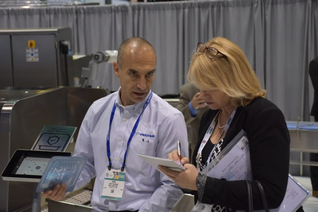 Multivac product manager Cem Yildirim runs through the features of the equipment on display at Pack Expo with PKN editor Lindy Hughson.