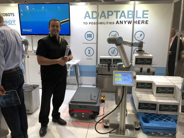 Craig Taylor showing Universal Robot cobots in action on the shared stand of The Robot People and Mobile Automation.