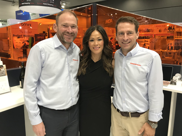 Foodmach's Phil Biggs (left) and Tim Baron with Liza Nelson of Systech International.