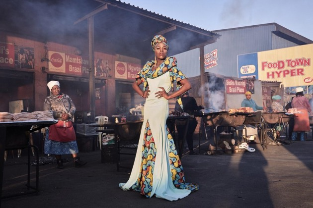 © Lee-Ann Olwage. 2020 Photo Contest, Portraits, Singles, 2nd Prize. Black Drag Magic - Portrait of a Drag Artist and Activist. Belinda Qaqamba Ka-Fassie, a drag artist and activist, poses at a shisanyama—a community space where women cook and sell meat—in Khayelitsha, a township located on the Cape Flats, near Cape Town, South Africa.