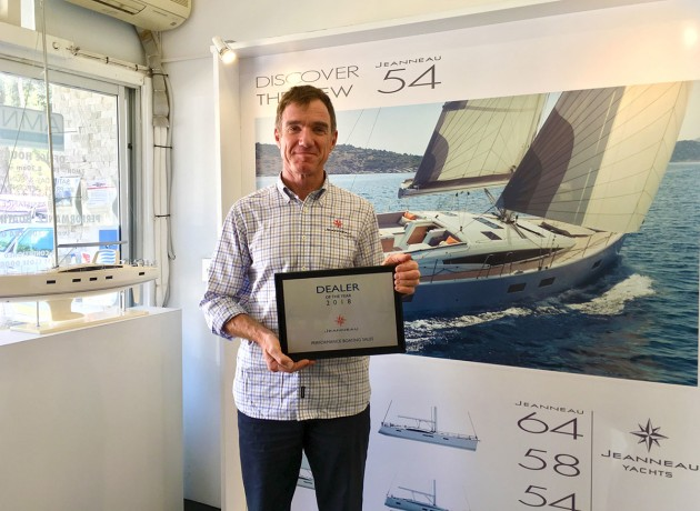 Lee Condell with the Jeanneau Dealer of the Year award presented to Performance Boating Sales.