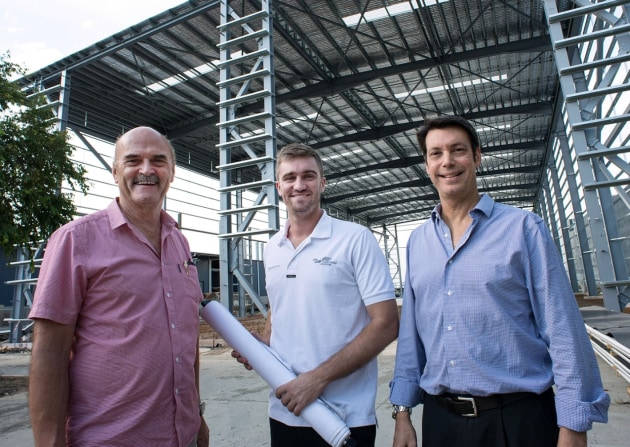 Building for the future: Maritimo general manager operations Phil Candler, lead designer Tom Barry-Cotter and CEO Garth Corbitt inspect one of the new buildings under construction.