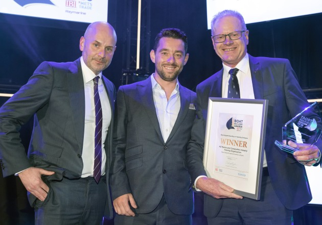 NZ Marine's Peter Busfield (right) receives the award in Amsterdam from Boat Builder Awards presenters Ed Slack and Nick Hopkinson.