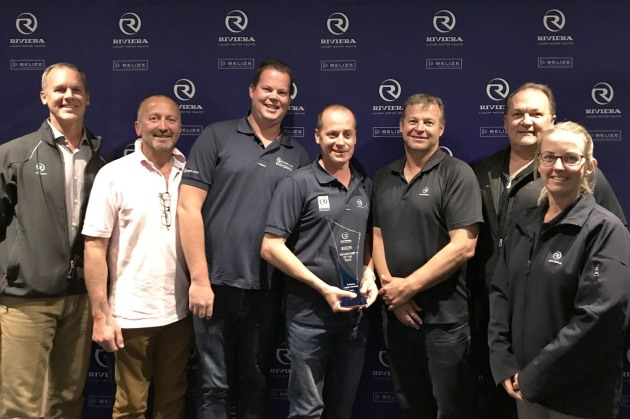 Paul Harrop, principal of R Marine South Australia (centre) accepts the award for Dealership of the Year with Riviera owner Rodney Longhurst (far left), dealer relationships manager Peter Welch (third from right), Riviera CEO Wes Moxey (second from right) and sales and planning manager Nicole Stewart (far right).