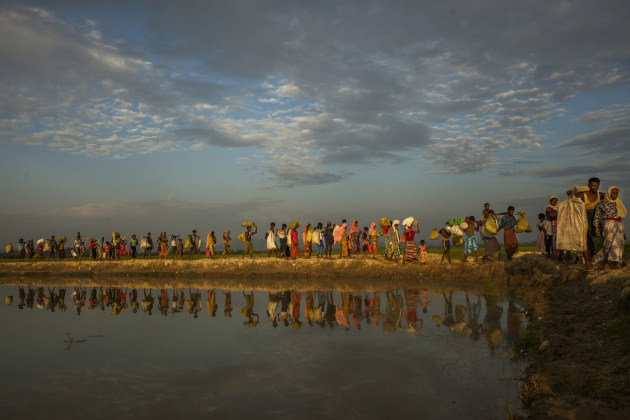 © Salahuddin Ahmed. Rohingya ethnic minority people are entering from the Anjuman Para Boarder near Cox's Bazar, Bangladesh, after a whole day wait in the no man's land on 2 November, 2017. Salahuddin Ahmed won the 2018 Ian Parry Award for Potential.