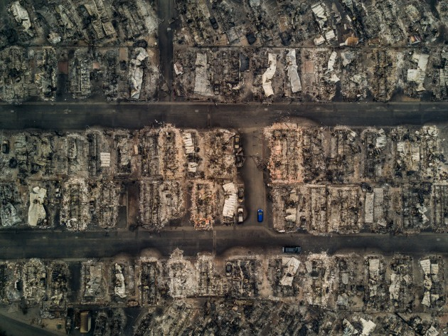 © Josh Haner/The New York Times. Fire aftermath, 10/10/17. Fire aftermath at Journey's End Mobile Home Park, Santa Rosa, California.
