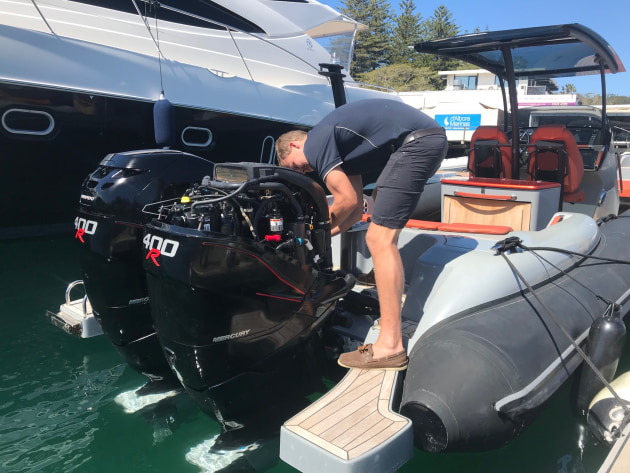Working on twin twin Mercury Verado 400R outboards.