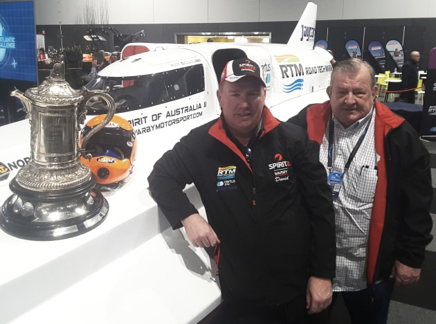 Dave and Ken Warby at the Sydney International Boat Show with the trophy awarded to the holder of the world water speed record - held for 40 years by Ken.