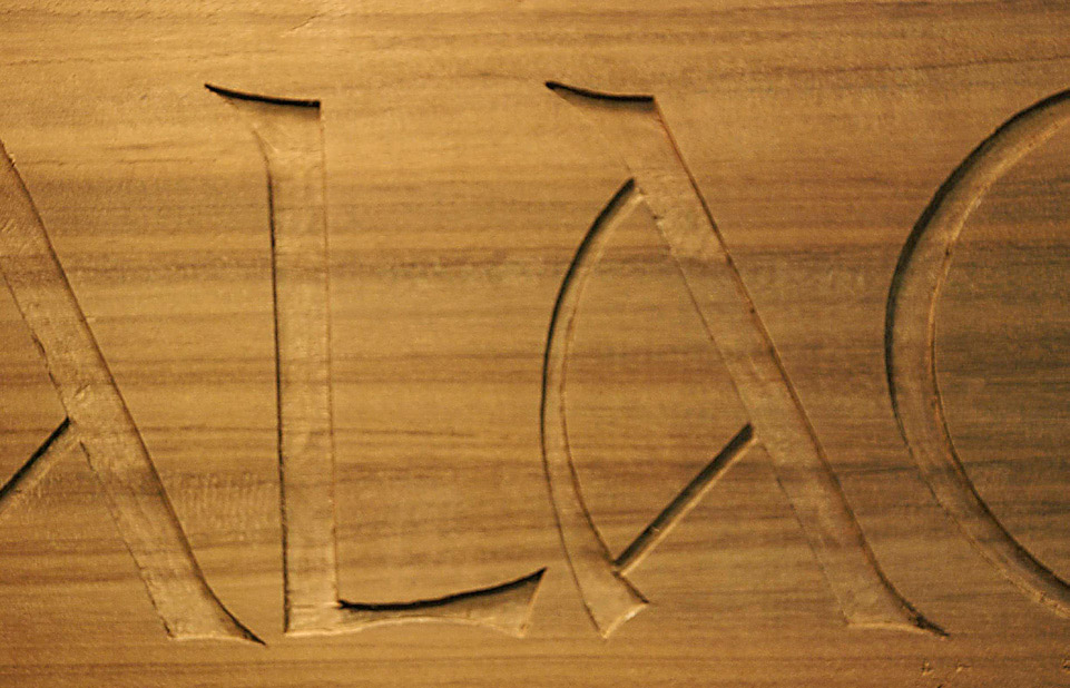 i had a few rough cut 1360mm long boards of walnuta species im partial to carving i planed the board and sketched the words on