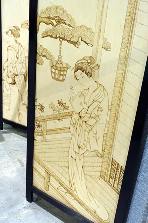 Screen with pyrography by Neville and Alyssa Pike.