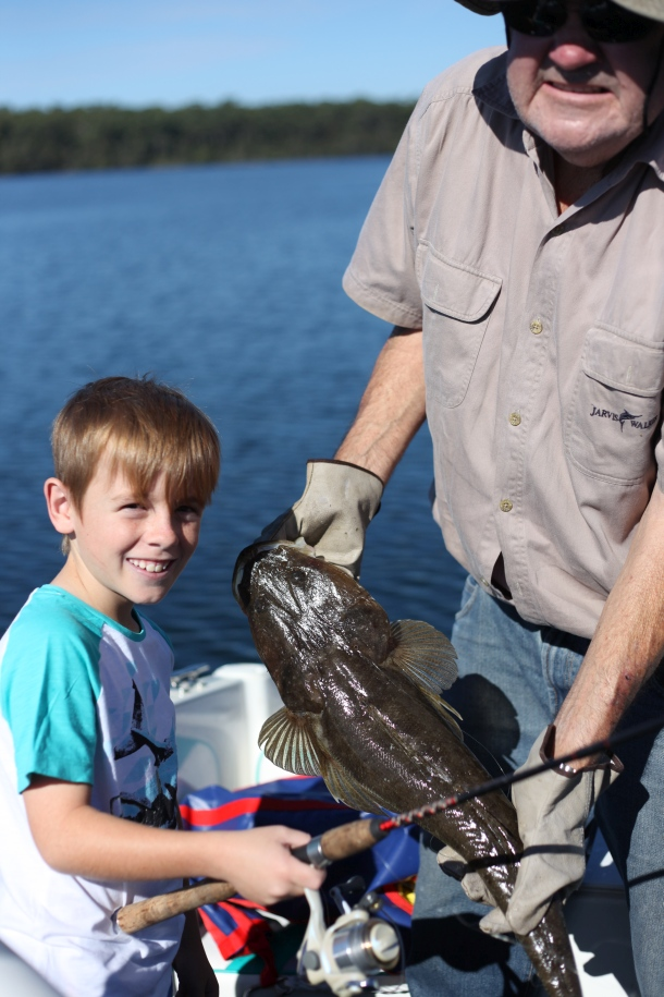 Eight-year-old Ryan Richards' first of two dusky flathead, caught in St Georges Basin while fishing with his Pop.