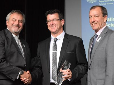 (L-R) Chief Defence Scientist Dr Alex Zelinsky, Minister's Award winner Dr Mark Patterson, and the Minister for Defence Materiel and Science Mal Brough. Credit: DST Group