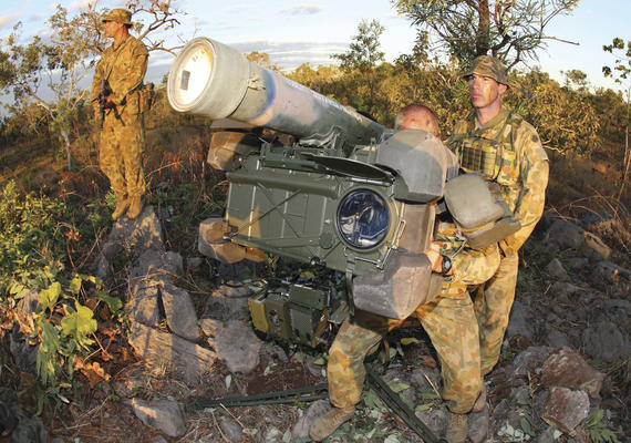 Members from 16 Air Defence Regiment provide air defence at Tindal. Gunner Scott Clarke (rear left) maintains watch at an RBS-70 Ground Based Air Defence missile battery manned by GNR Murray Keogh (obscured) and Bombardier Nicholas Selzer (right). Credit: Defence