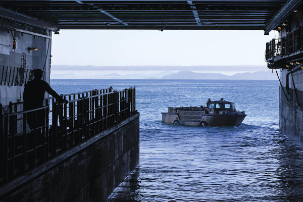 An Australian Army light amphibious vehicle from 10th Force Support Battalion leaves HMAS Adelaide during Exercise Sea Explorer 2016, off the coast of North Queensland, Australia, on 28 June 2016.