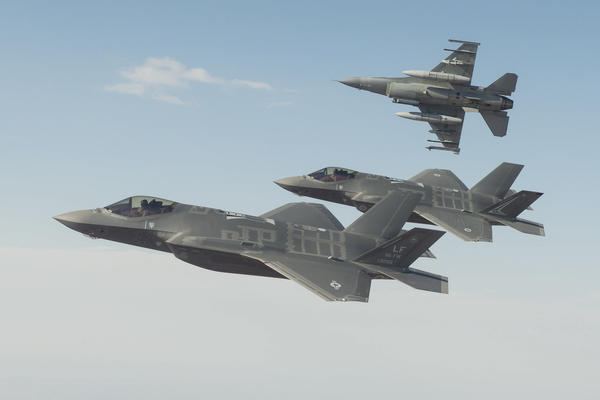 A Royal Australian Air Force F-35A flies in formation with a US Air Force F-35 and F-16 during trial flights from Luke Air Force Base in Phoenix Arizona. Credit: Lockheed Martin