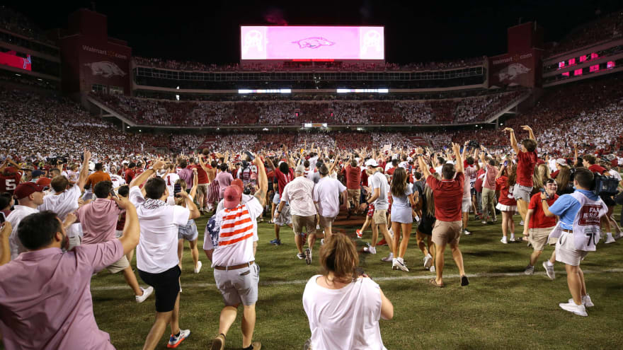 Arkansas fined for fans storming field after win over Texas