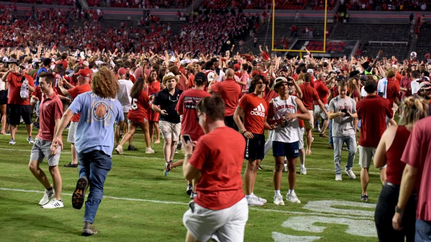 Watch: NC State fans storm the field after upset win over Clemson