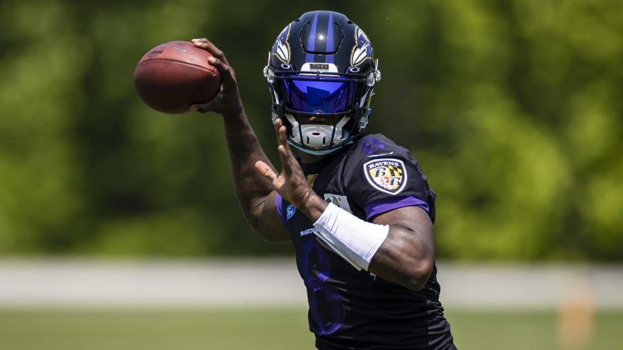 Lamar Jackson not at training camp due to COVID issues