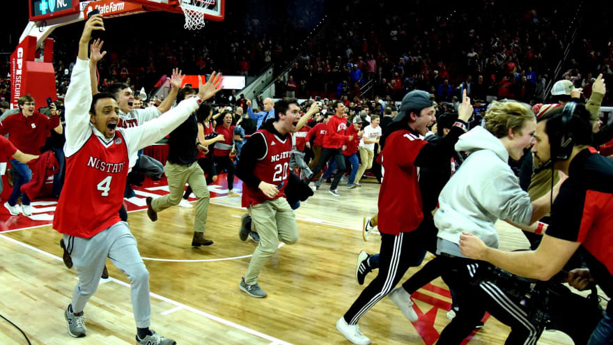 NC State fans storm the court after big win over No. 6 Duke