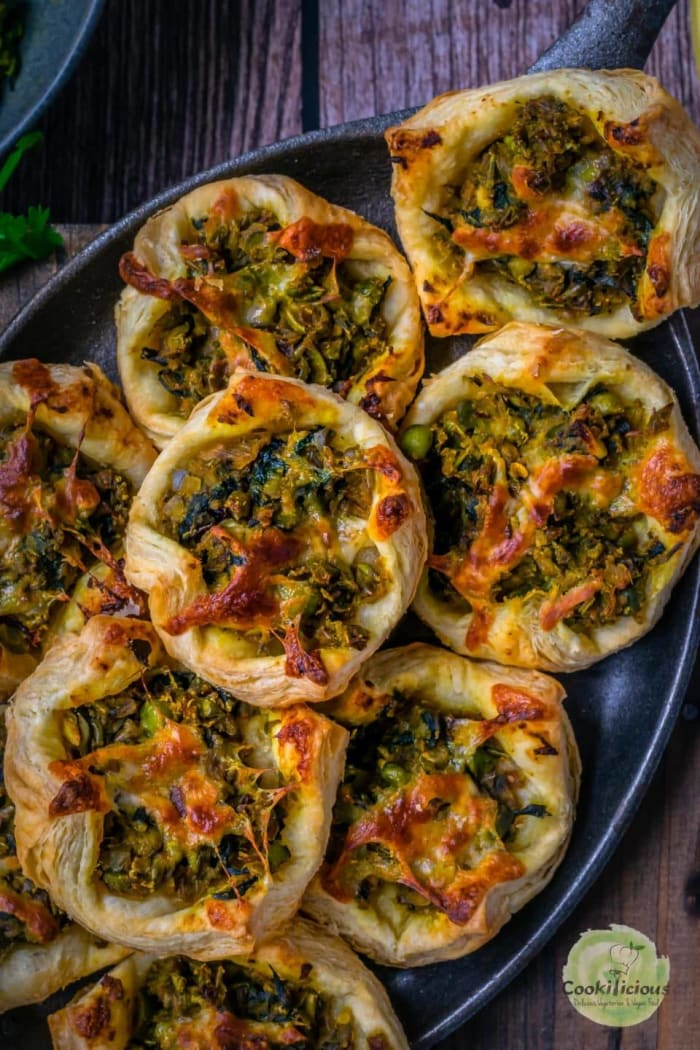 Homemade spicy green peas and spinach pastry puffs