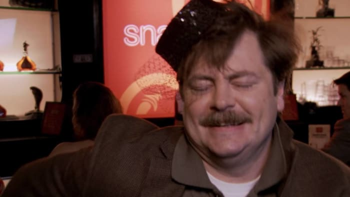 Ron dances drunk in a tiny hat