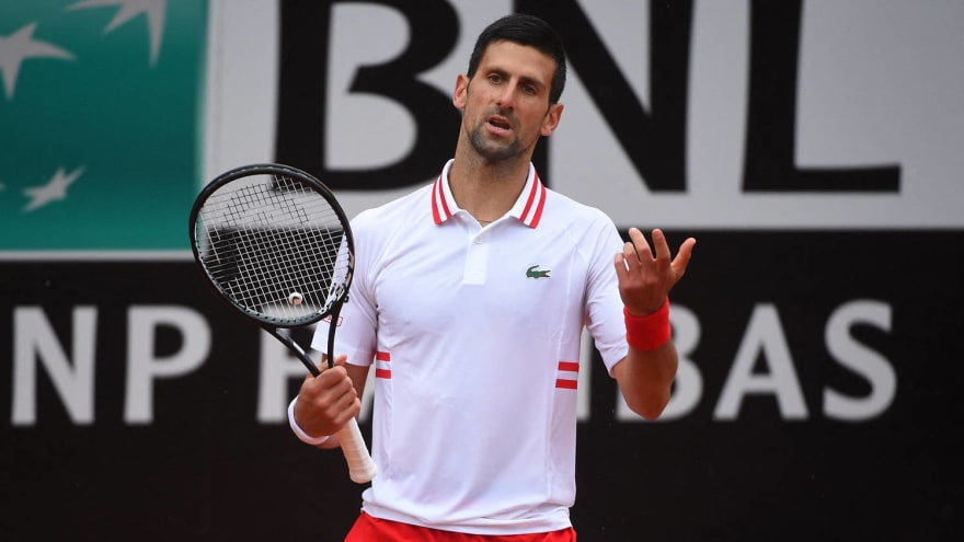 Djokovic goes off on ump for allowing match to continue in rain