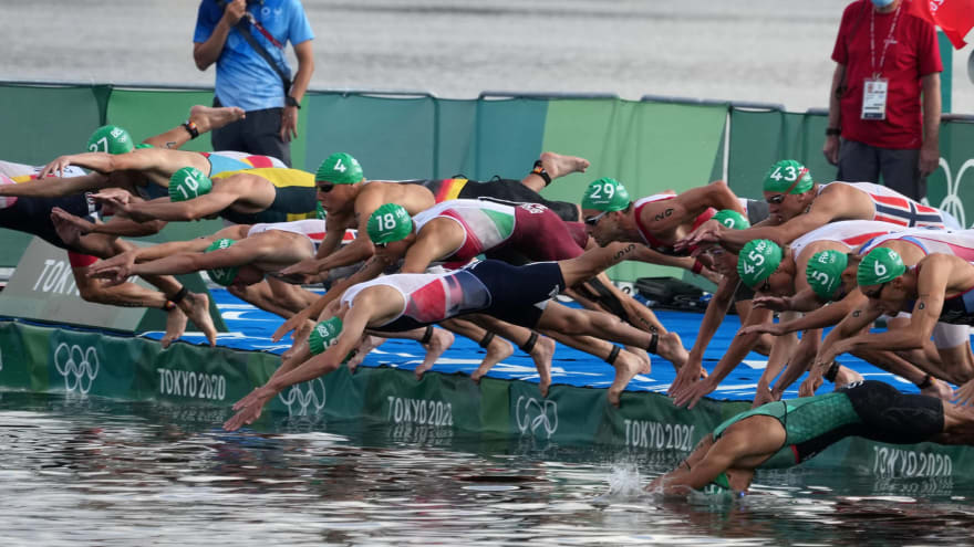 Boat disrupts start of Olympic triathlon competition