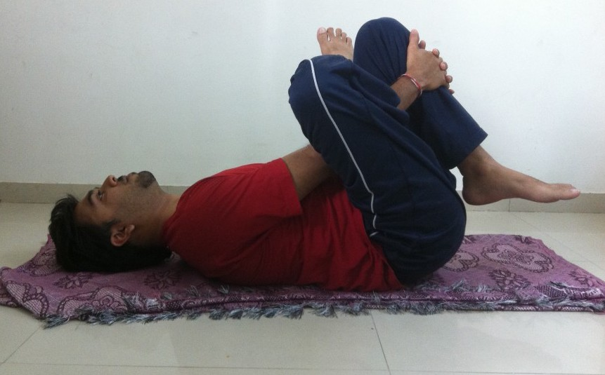 reclining half ankle to knee pose
