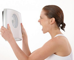 Woman frustrated at weight loss failure.