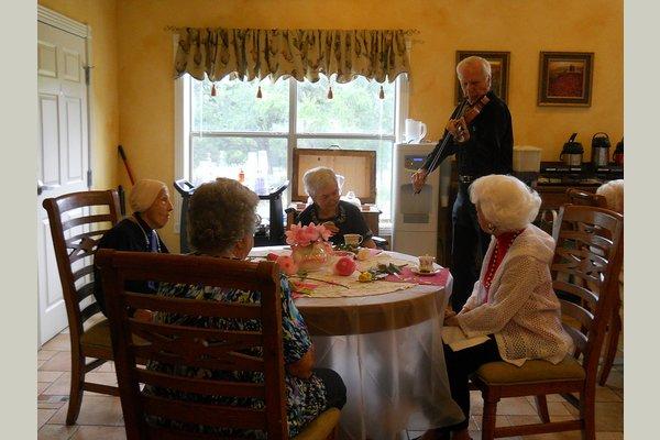 Sodalis Elder Living in Garden Ridge violinist at table