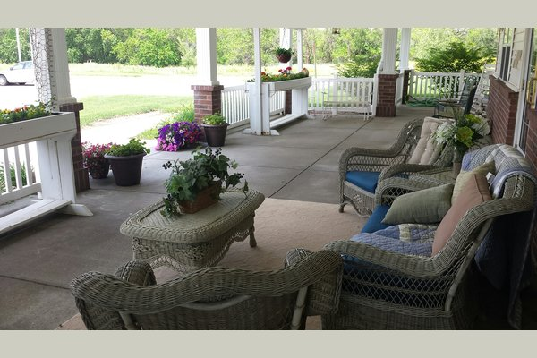 A summer afternoon on the front porch sipping lemonade, watching the wildflowers blow in the breeze and listening to the birds sing their songs...
