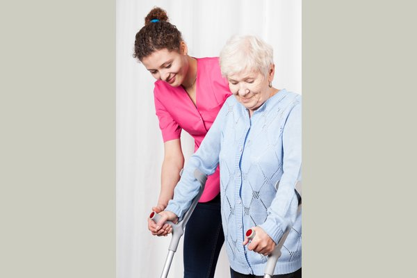 Caregiver Assisting in Ambulation