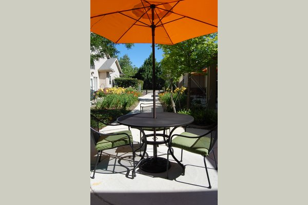 Our residents enjoy being outside on our secure patios.