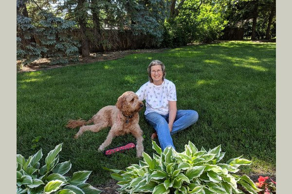 One of our residents with her best friend, Teddy. He is our on site therapy dog!