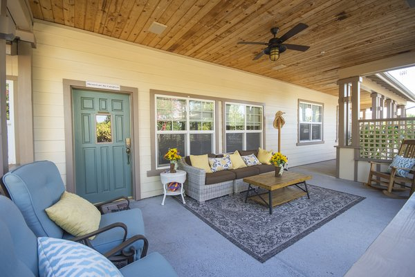 Roseberry's wrap-around porch entrance in this large craftsman home.
