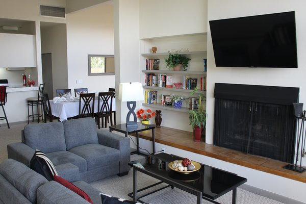 There is a large living room in each of the houses. They each have big screen TV and lots of books and DVDs. Each room also has wifi hookup for an additional charge.