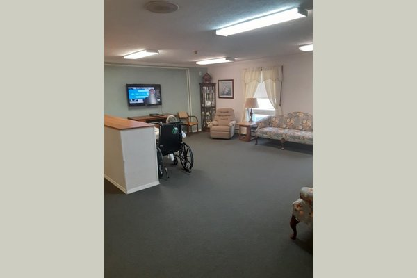 Residents love gathering in the living room for activities, movies and for visiting with loved ones.  Look for an exciting renovation coming soon!