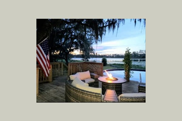 Enjoy the night by our fireplace with comfortable outdoor seating over looking the pool and lake.