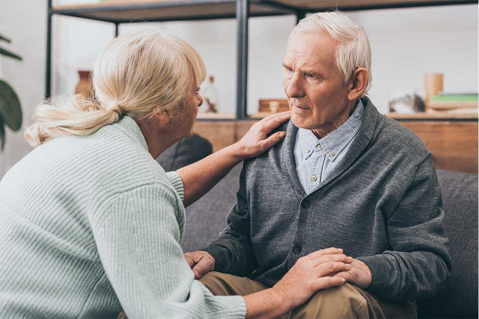 Female family caregiver helping her husband overcome signs of dementia.